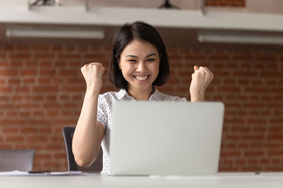 woman-cheering-laptop